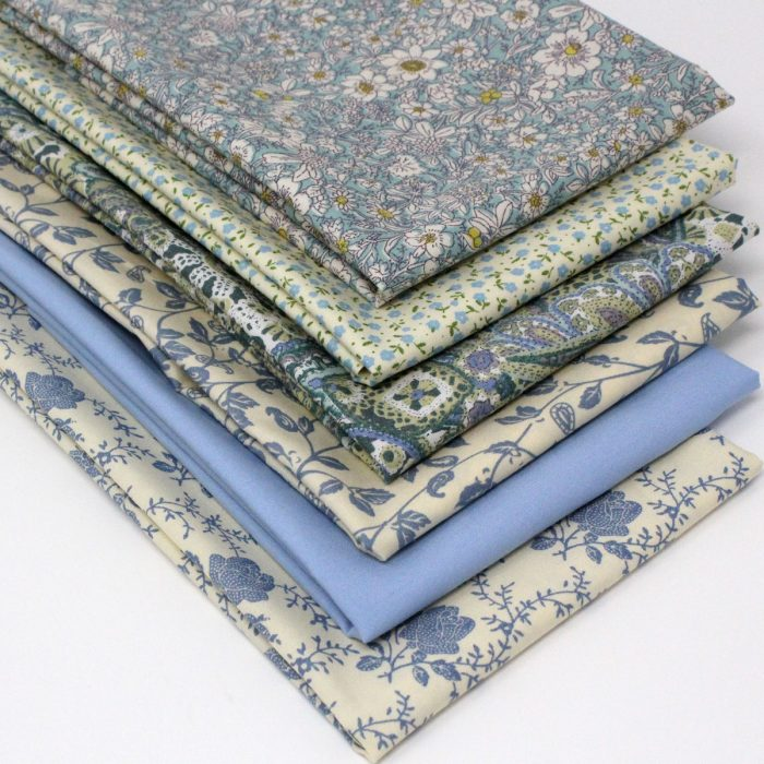 Delicate floral prints in shades of pale blue.
