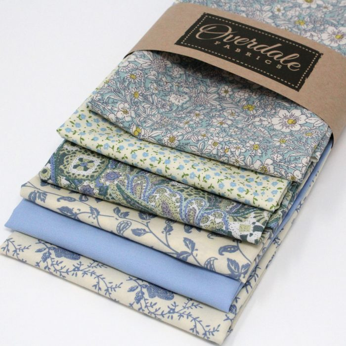 A pack of six fat quarters in shades of blue with a delicate floral theme.