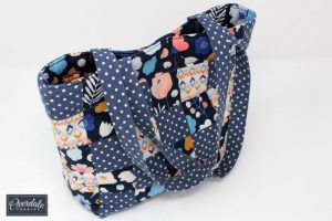 Patchwork handbag in blue and peach.