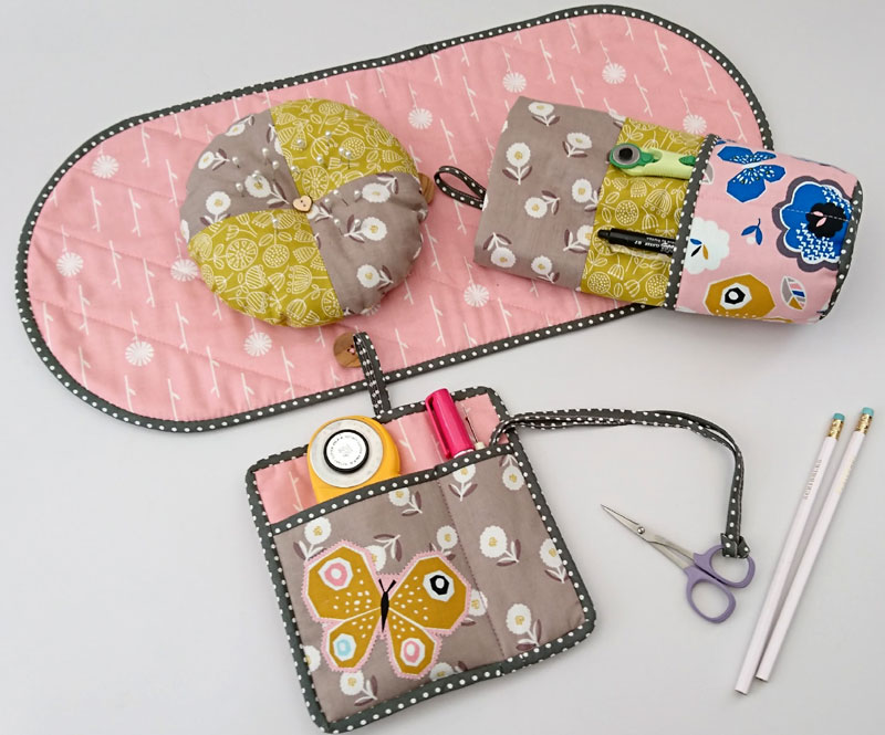 Handcrafted pockets, pincushion and thread catcher for a sewing caddy.