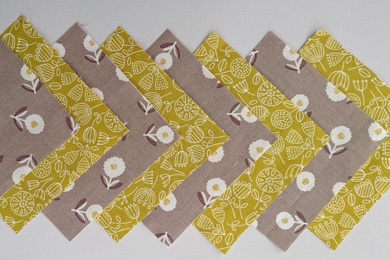 Fabrics for sewing a patchwork pincushion.