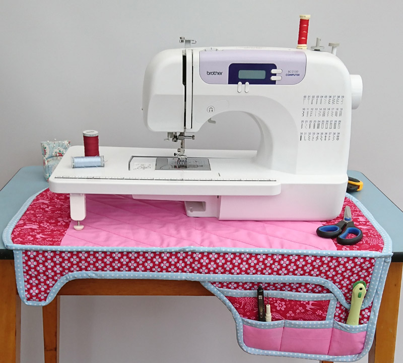 A sewing machine mat with storage panels featuring fabrics from Overdale Fabrics Cotswold Country fat quarter pack.