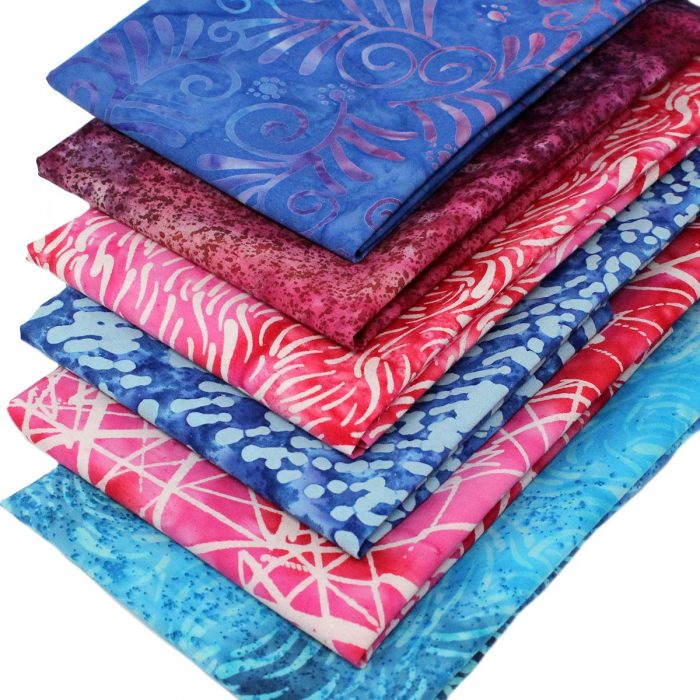 Batik fabrics in pinks and blues.
