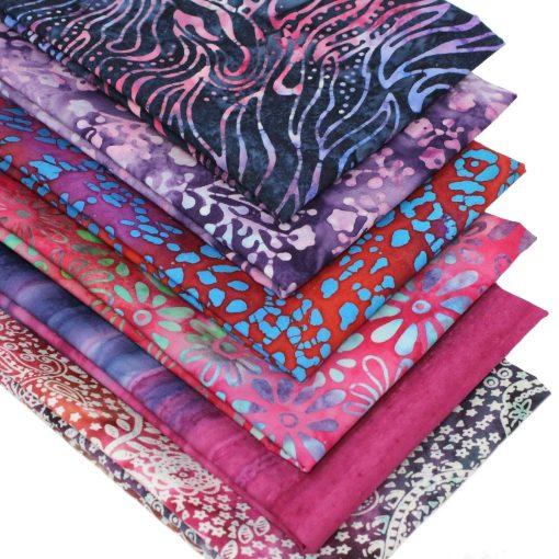 Batik fat quarter fabrics in pink, blue and purple.