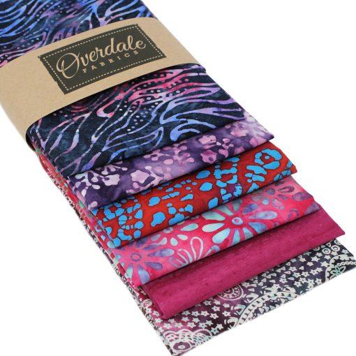 Purple, blue, pink batik fabrics in a fat quarter pack.