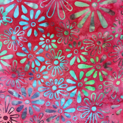 Pink batik fabric with a blue and purple daisy pattern.