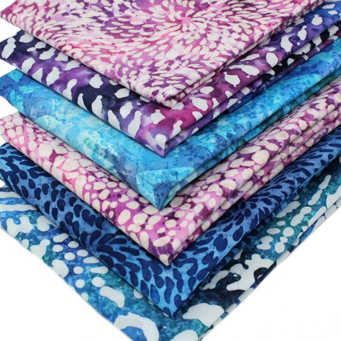 Batik fat quarter collection in pinks, blues and purples.