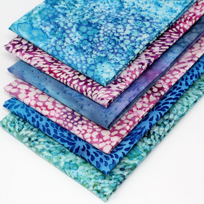 Batik fabric designs in blues, pinks, purples and greens.