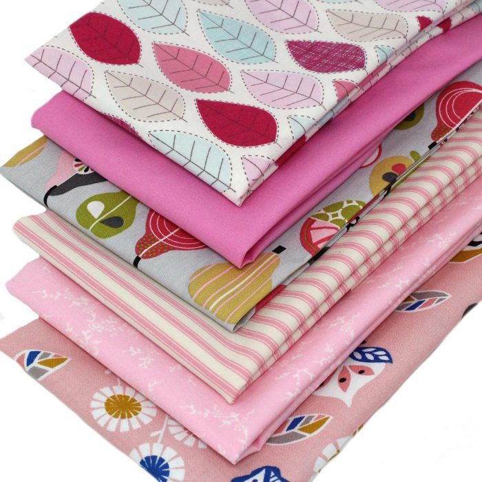 A range of pink fat quarters with a pink theme.