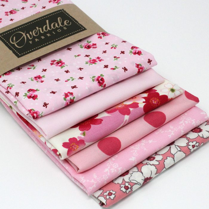 A pack of six fat quarters in shades of pink.