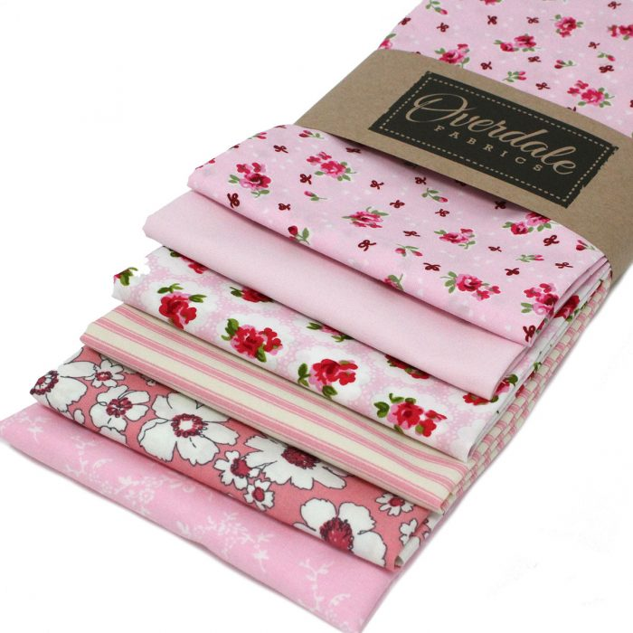 Pink fat quarter stash builder fabrics.