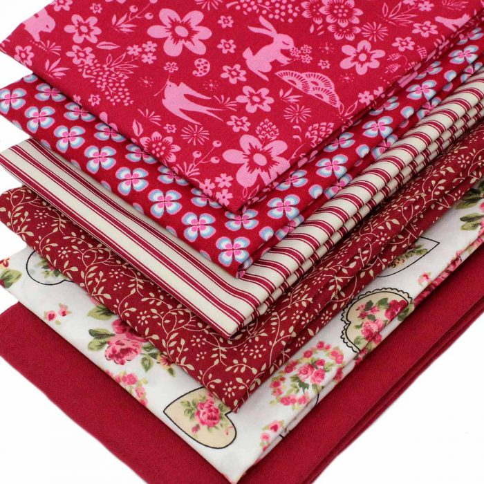 A set of red fat quarters.