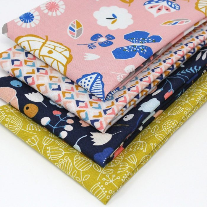 Pink and blue floral fat quarters by Dashwood Studios.
