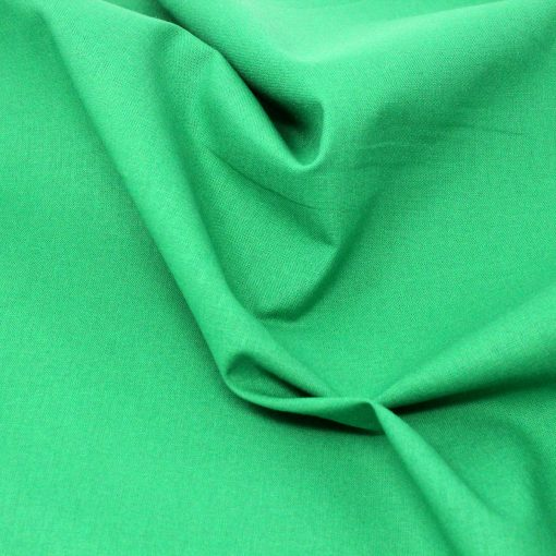 green solid fabric.