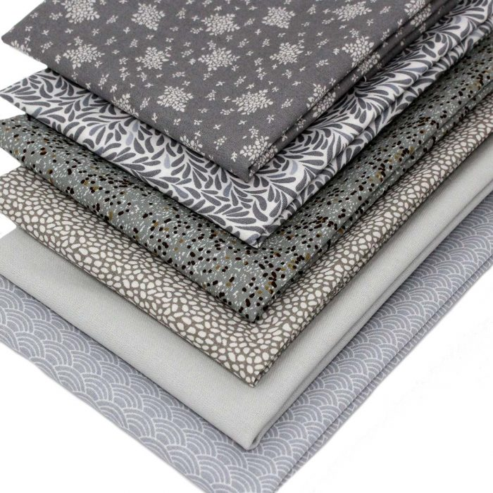 grey fat quarter pack with six designs.