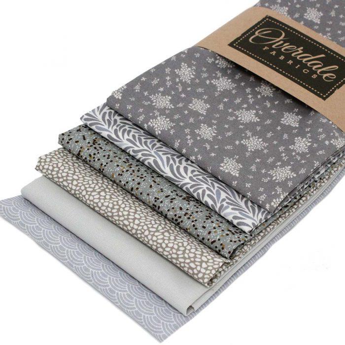 Six fat quarter pack of grey fabric designs.