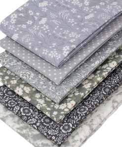 Fat quarter fabrics in shades of grey.
