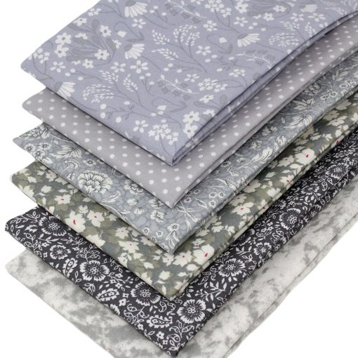 Fat quarter fabrics in shades of grey.