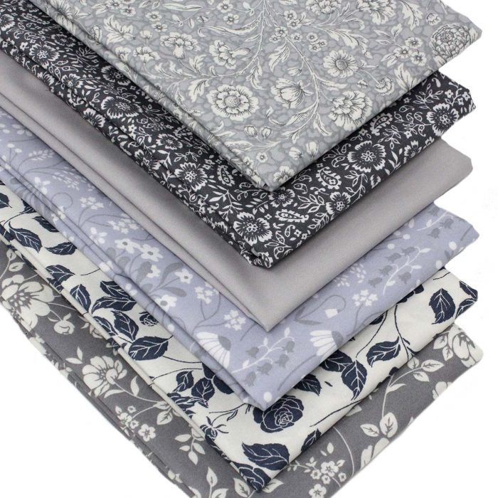 Floral fat quarter fabrics in shades of grey.