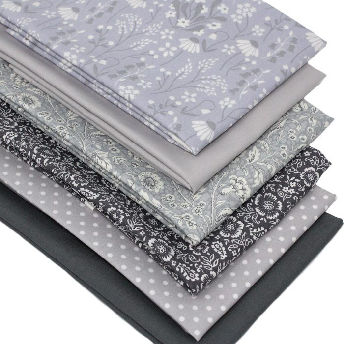 Grey fat quarter fabrics with a floral theme.