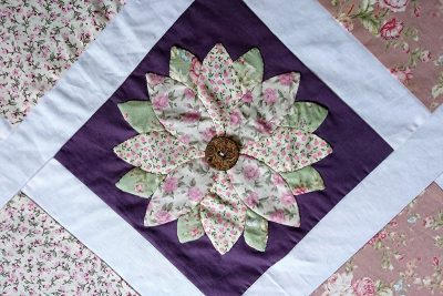 Applique rose as the centre decoration on a quilted table runner.