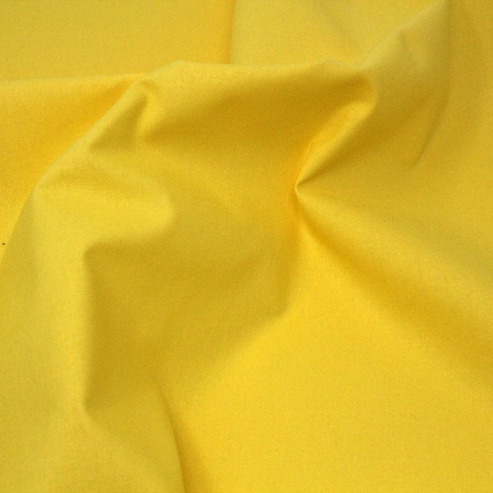 Yellow plain solid fabric.