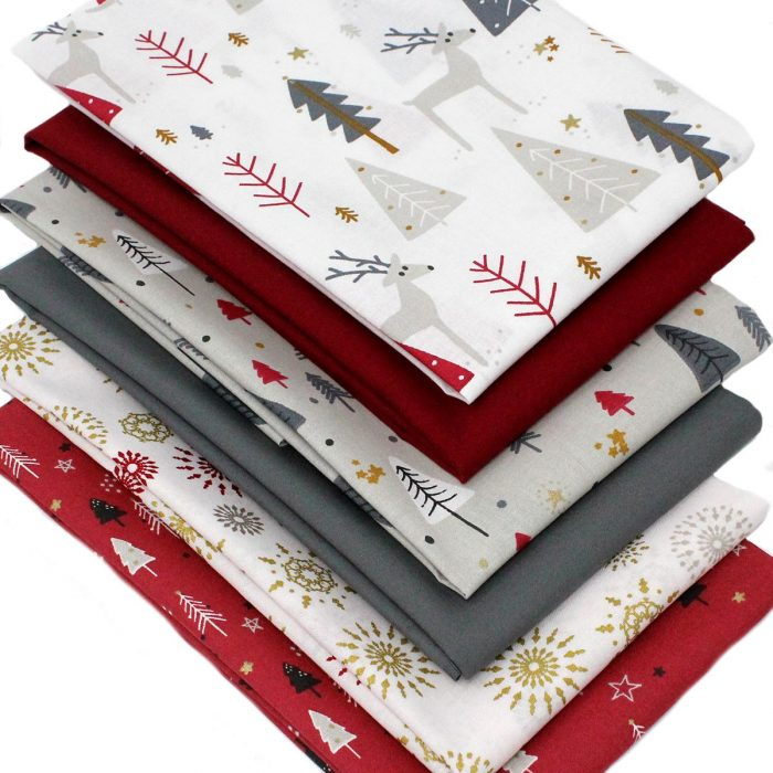 Christmas themed fat quarter fabrics in red and grey.