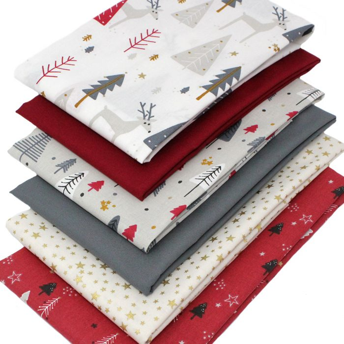 Christmas fabrics in red, grey and gold.