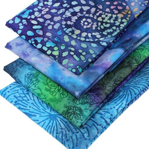 Blue, purple and green batik fabrics.