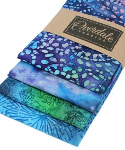 Batik fat quarter fabrics in purple, blue and green.
