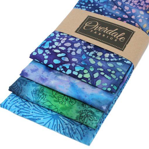 Batik fat quarter fabrics in purple, blue and green.