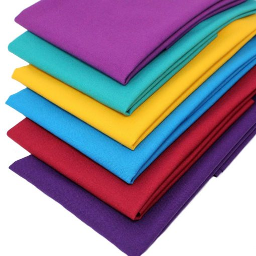 Solid coloured fabrics in jewel colours.