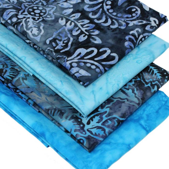 Blue batik fat quarter pack with a water look.