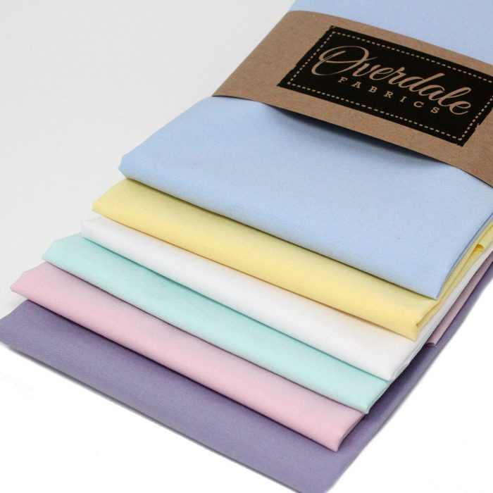 Cotton fat quarters in pastel shades.