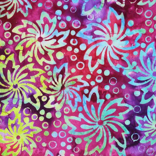 Batik fabric featuring a tropical flower in pink and purple.