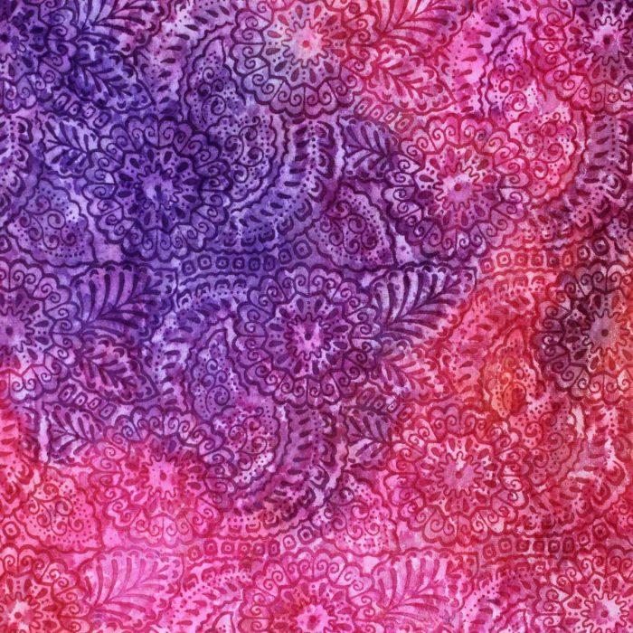 Block print batik fabric in red and purple.