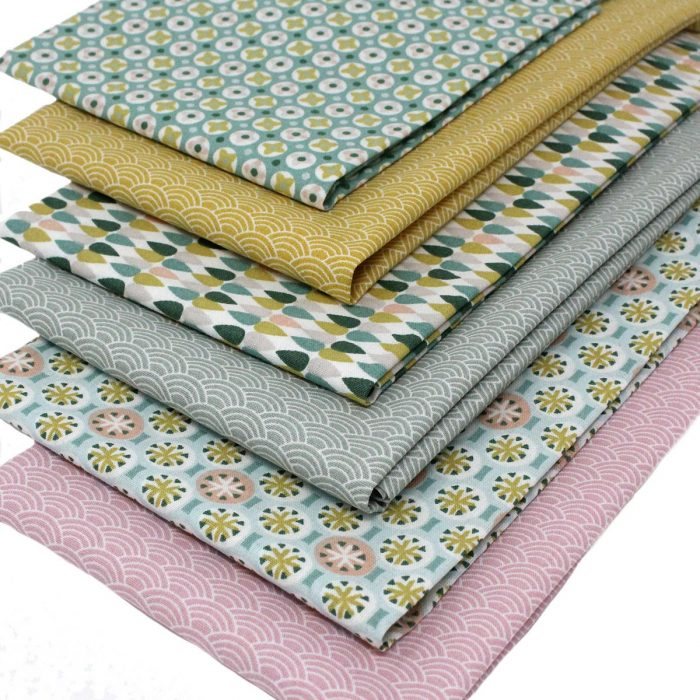 fat quarters with pastel colours and small printed designs.