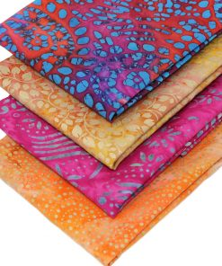 Red, orange, pink and gold batik fabrics.