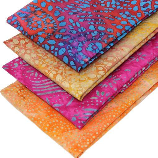 Red, orange, pink and gold batik fabrics.