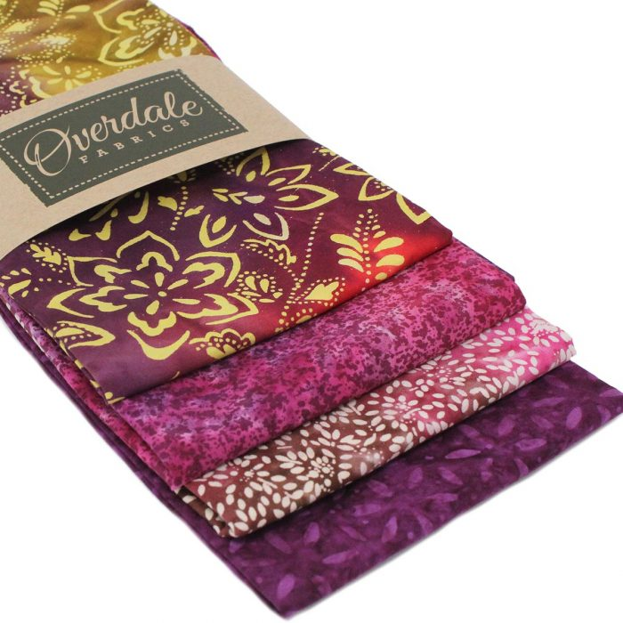 Batik fat quarters in pinks and purples.