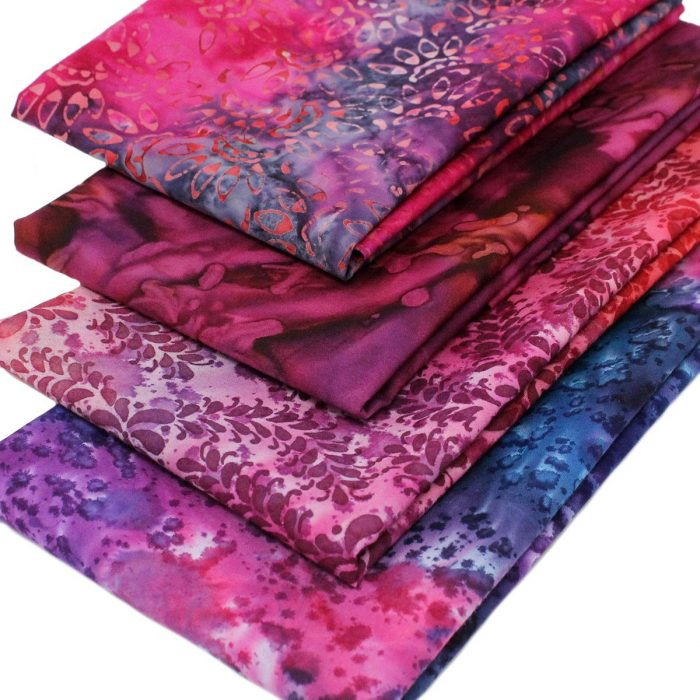 Pink and purple batiks in a 4 fat quarter collection.