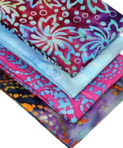 Batik fat quarter fabrics with a tropical look in blue, pink and purple.