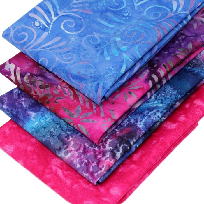 Batik fabrics with leaf patterns in tropical colours