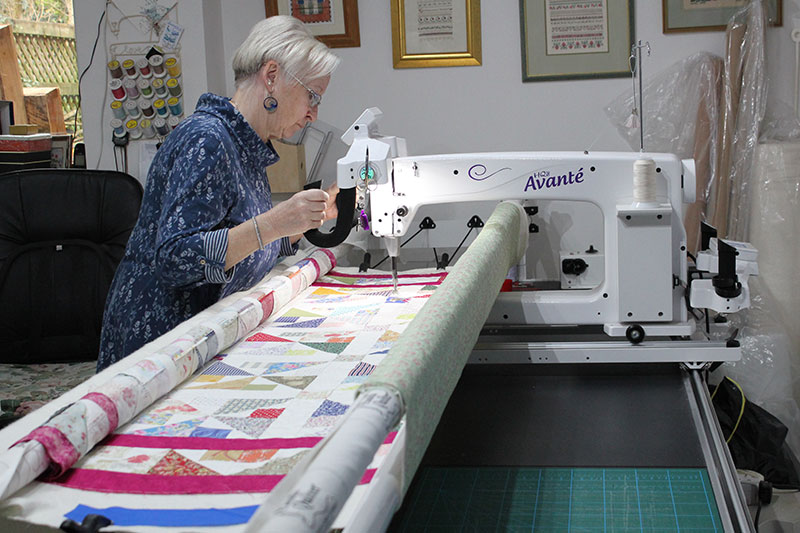 Mary using her Avante long arm quilter.
