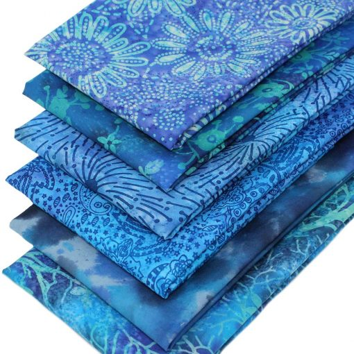 Blue batik fat quarters featuring flower and leaf designs.
