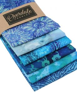 Blue batik fabrics featuring flowers and leaves.