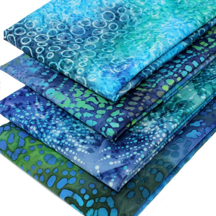 Blue and green batiks with a water effect.