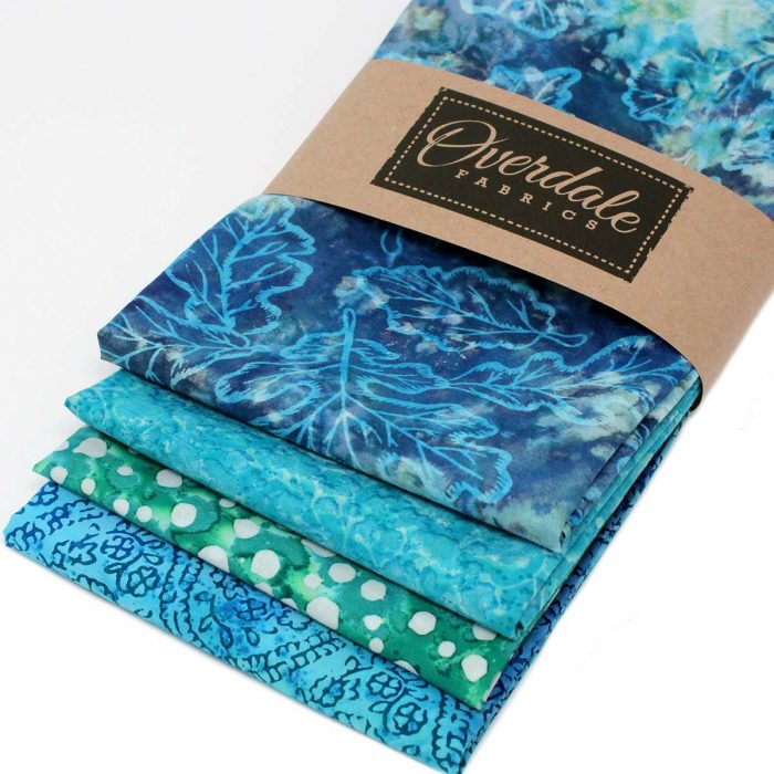 Four batik fat quarter bundle in green and blue.