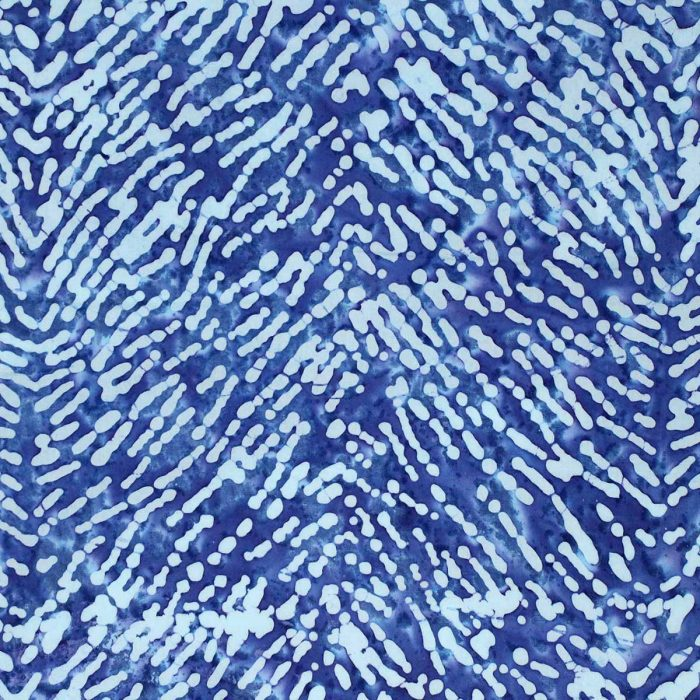 Blue batik fat quarter with line design.