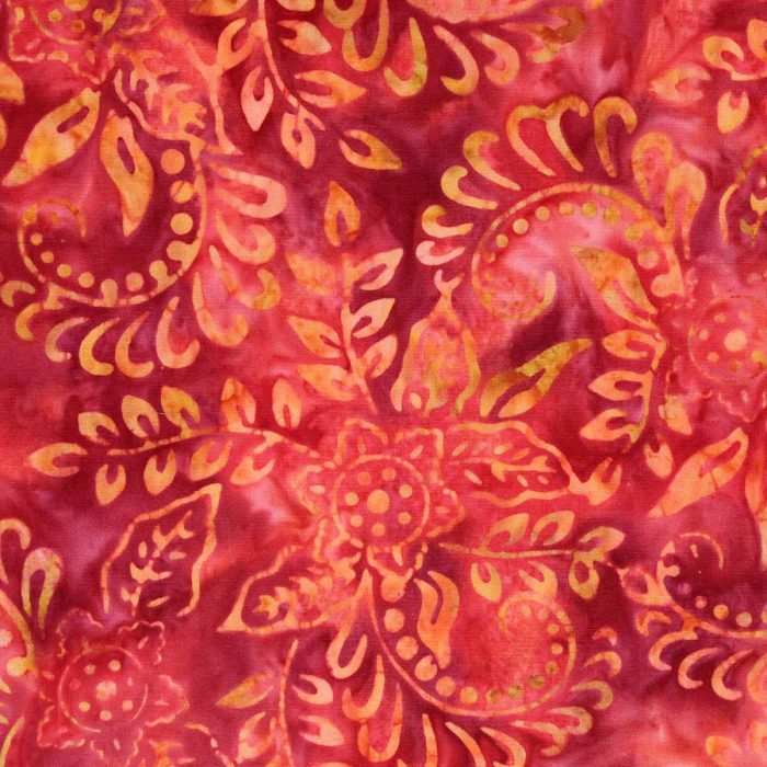 Rich red and orange batik fabric with a floral design.